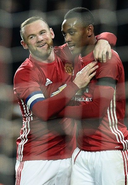 Manchester United's French striker Anthony Martial (R) celebrates scoring his team's third goal with Manchester United's English striker Wayne Rooney during the EFL (English Football League) Cup quarter-final football match between Manchester United and West Ham United at Old Trafford in Manchester, north west England, on November 30, 2016. / AFP / Oli SCARFF / RESTRICTED TO EDITORIAL USE. No use with unauthorized audio, video, data, fixture lists, club/league logos or 'live' services…