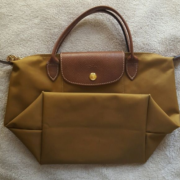 Longchamp Longchamp mini le pliage. Camel color. Corners are a bit frayed as shown in picture. Inside has some color marks. Long Elegant Legs Bags