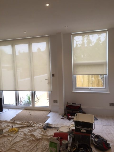 Sunscreen Roller Blinds Fitted To An Open Plan Kitchen Living Room With Bifold Doors Leading