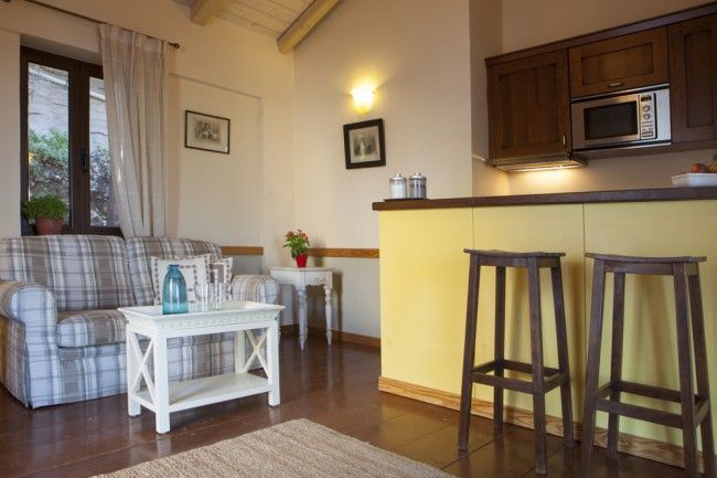 The living, dining, kitchen areas are both compact and open plan. The mini-kitchen, housed behind a small breakfast bar, although quite small has all the essential equipment necessary