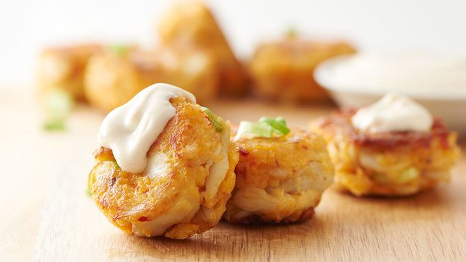 These cute crab cakes' small shape makes them easy to turn in the pan – but it also makes them easy to eat at a party!
