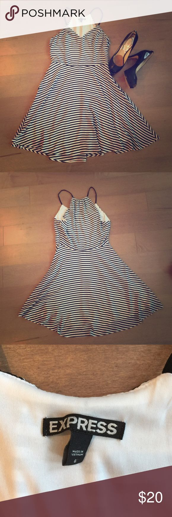 Express black and white striped party dress Fit and flare. Slight V-neck, thin straps, side zip, thin black and white stripes. Express brand. Polyester Express Dresses Midi