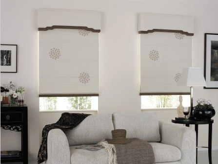 this art deco inspired pelmet shape has brought an understated touch of elegance to these roman blinds which would of otherwise seemed a little unfinished