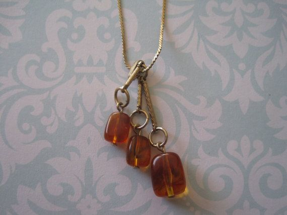 Vintage Amber BEad Drop Necklace  US$15.00 plus shipping!  https://www.etsy.com/ca/listing/210309790/vintage-amber-bead-drop-pendant-necklace?ref=shop_home_active_11