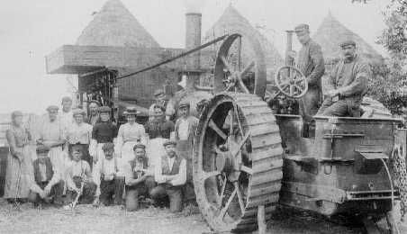 33. OLD THRESHING MILL his scene was photographed at Masterfield farm. A long belt from the traction engine, creating great potential for accidents if a worker got carelessly near it or if it broke, powered the mill itself into which the sheaves of grain were pitchforked.