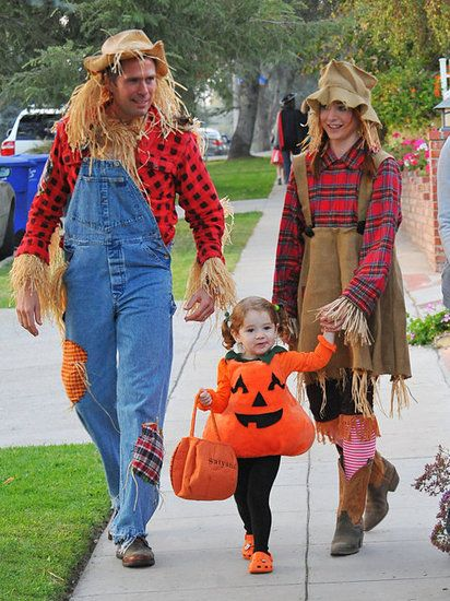 : Alyson Hannigan and her husband, Alexis Denisof, got into the spirit as scarecrows with their daughter as a pumpkin in LA in 2011.