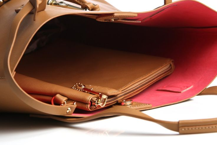 """Weve Bag Co's """"Suze"""" in stark rich tan is an understated large tote with contrast hot pink interior that evokes a capacious silhouette in a refined design. It w"""