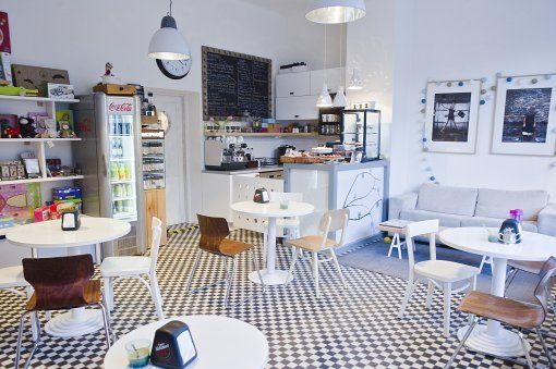 I like the small floor tiles. The space is airy and the set up makes it feel more like a living room