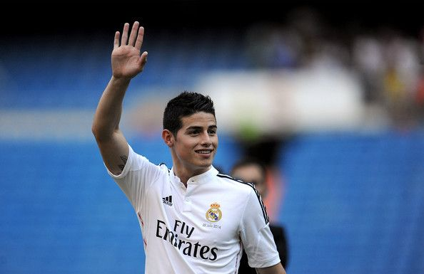 James Rodriguez Photos Photos - James Rodriguez waves to fans during his unveiling as a new Real Madrid player at the Santaigo Bernabeu stadium on July 22, 2014 in Madrid, Spain. Real agreed to buy Rodriguez from AS Monaco for the next six seasons for an undisclosed transfer fee. - James Rodriguez Officially Unveiled at Real Madrid