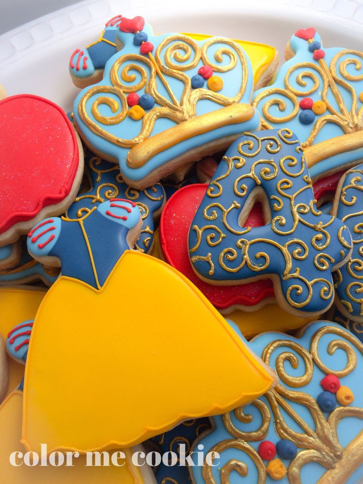 This listing is for one dozen (12) Snow White themed sugar cookies. Baked in my licensed kitchen, you will receive 3 of each of these cookie shown in the photos (gold tiara, Snow Whites dress, an apple, and any number.) They will all come individually wrapped in clear cellophane bags. They make the perfect addition to any dessert table, gift for your favorite family member or friend, or favors to give out to your special party guests. I can make these cookies into party favors by adding a…