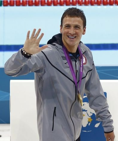 United States' Ryan Lochte wears his gold medal as he waves to spectators after the medal ceremony for men's 400-meter individual medley swimming final at the 2012 Summer Olympics, Saturday, July 28, 2012, in London. (AP Photo/Daniel Ochoa De Olza) Photo: Daniel Ochoa De Olza, Associated Press / SF