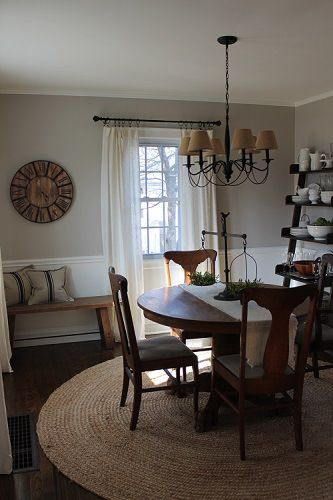 Casual and neutral dining room painted Benjamin Moore London Fog and Simply White.  Antique table and round jute rug.