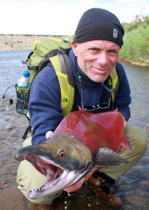 NORTHERN EXPOSURE: Ipswich-born and Suffolk-raised Jeremy Wade - and friend! (a salmon) - in Alaska. It's a far cry from the River Stour . . . Pictures: Icon Films, Bristol