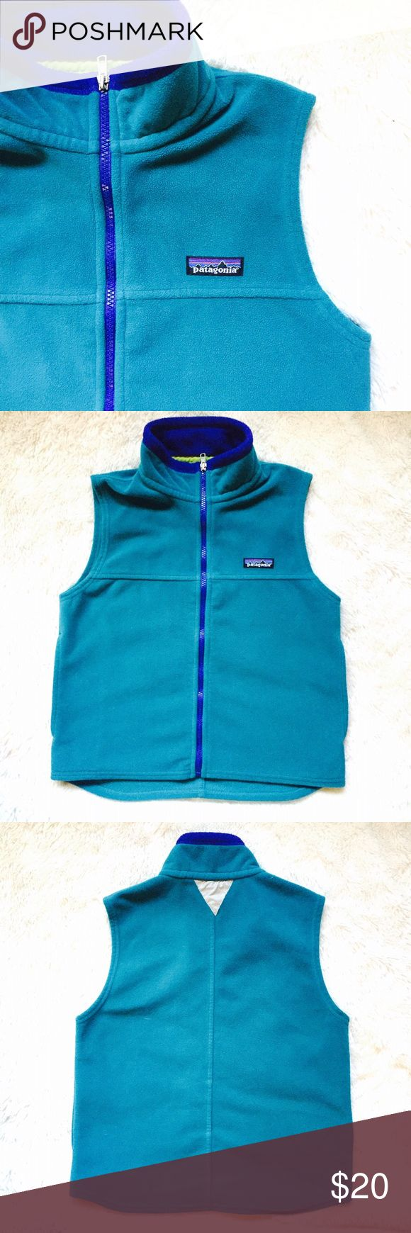 "🆕 Kids Patagonia Vest 7/8 Great fleece vest by Patagonia I believe the style is synchilla. In a gorgeous aqua blue turquoise color with a dark blue trim. Would look great on a boy or a girl. Kids size small S 7/8. In excellent preowned condition ready to wear. Measures approximately 17.5"" across the chest and 20"" in length. Patagonia Jackets & Coats Vests"