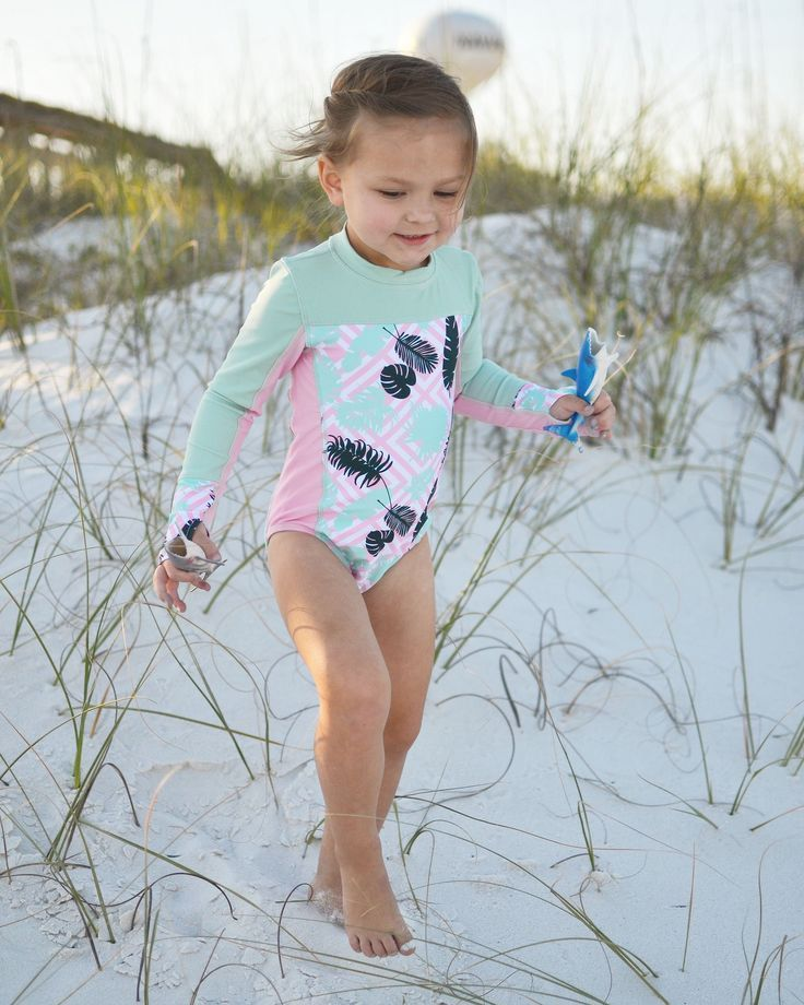 7b4f18a2d3e2c SwimZip's girl bodysuit is a sun protective rash guard and swimsuit in one!  It's perfect for summertime fun by the seashore, or running through the ...