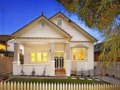 Cream and light grey Californian Bungalow. Barge boards have been painted grey-don't think this is a great idea to highlight them