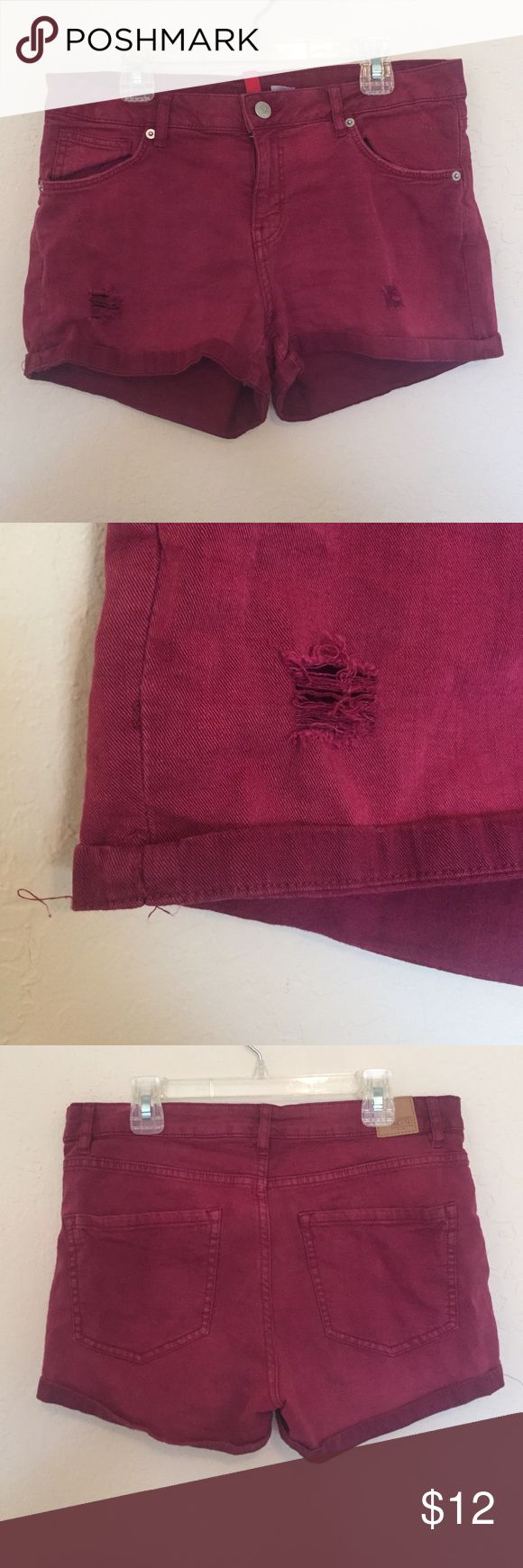 Maroon distressed denim shorts. Maroon shorts, distressed on front, lightly worn, from H&M. H&M Shorts Jean Shorts