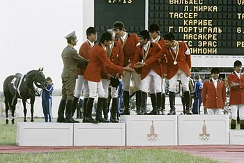 Polish and USSR Jumping riders congratulate each other after their medal-winning performances.
