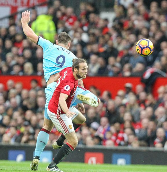 Burnley's Sam Vokes jumps for a header with Manchester United's Daley Blind during the Premier League match between Manchester United and Burnley at...