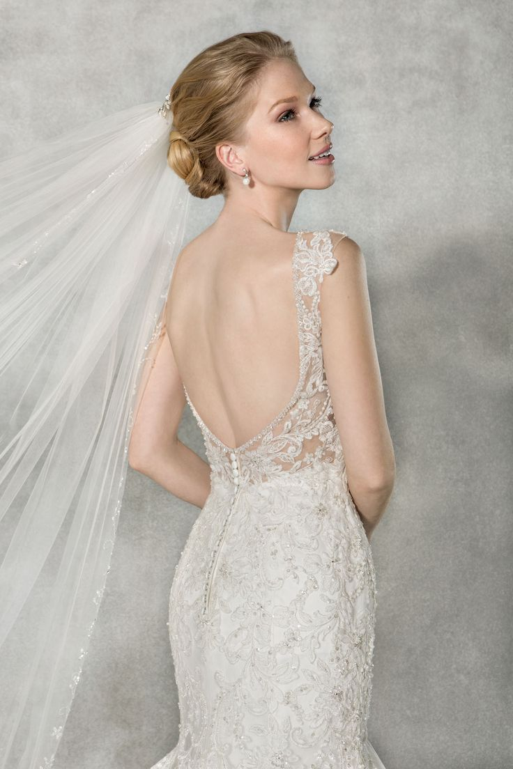 Look and feel a million dollars in this dazzling fishtail wedding dress 'Bexley', with a delicate beaded neckline and a stunning scoop back.