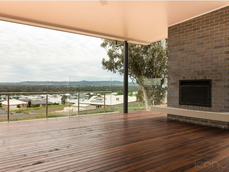 Beautiful deck with a view & Fireplace! #Australianhomes #iconobuildingdesign #outdoorliving #fireplace