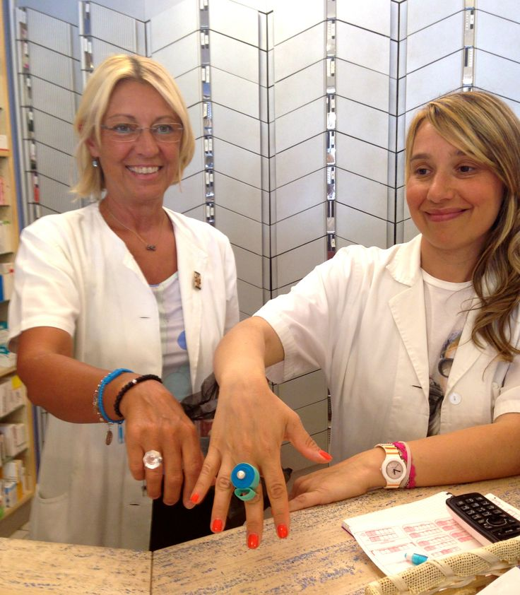 LOVE IT!  In the oldest pharmacy of Arezzo, Teresa and Stefania are working wearing multicolor rings of Floral Collection by Scicche and Sillymond rings for Scicche www.scicche.it