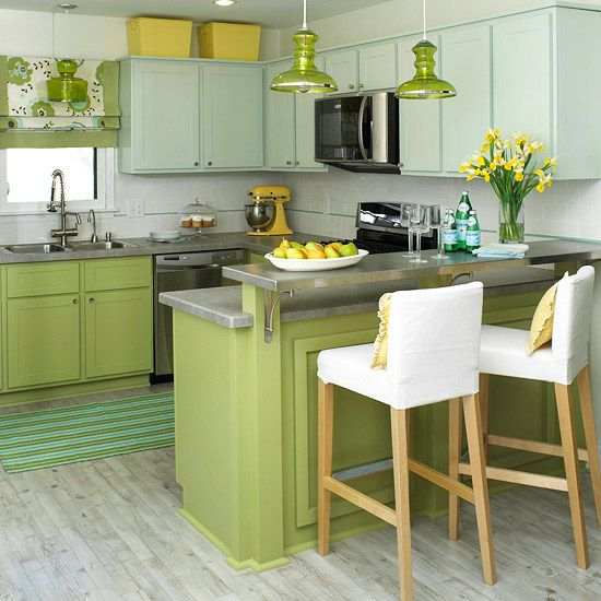 Cabinetry Makeover  Give outdated cabinetry a new lease on life with paint, your simplest and most affordable tool in a small kitchen update. Sanded, primed, and painted, the cabinets in this kitchen now gleam apple green on base cabinets and soft teal on upper wall cabinets. Appliances and storage bins in yellow add a citrus pop to the kitchen.