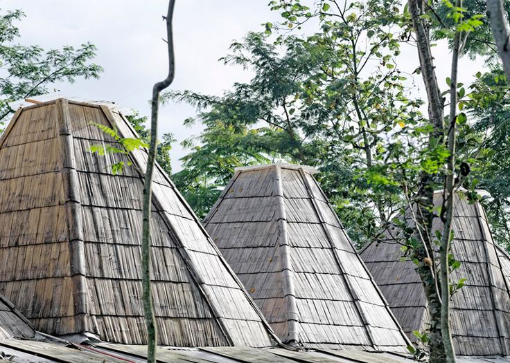 This house in the Indonesian city of Salatiga was designed with multiple bamboo funnels on its roof to echo the area's mountainous topography.