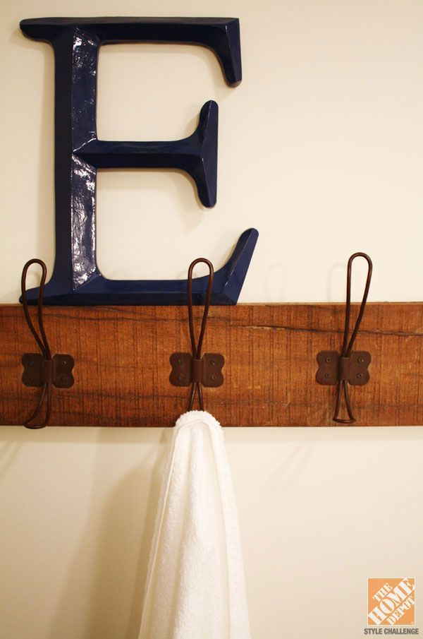 Towel hung on reclaimed wood and hooks in bathroom remodel