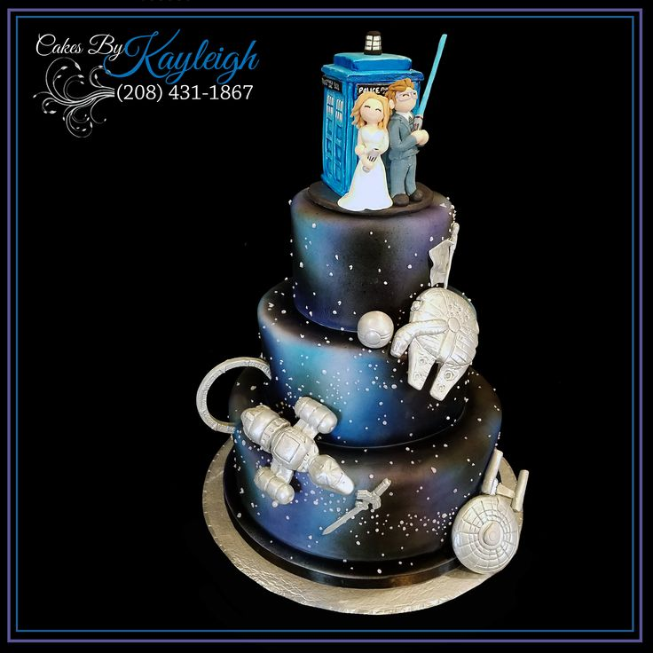 Awesome Fandom Wedding Cake.  All hand crafted fondant toppers.  Dr. Who Wedding cake topper.  Star Wars, Stargate, Star Trek, Zelta, Serenity, Pokemon, Harry Potter.