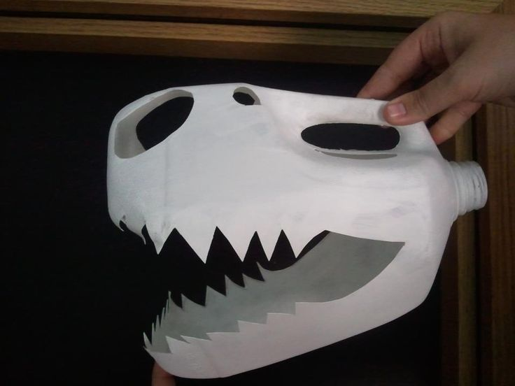 Genius DIY decoration idea for a dinosaur party - T Rex skull made out of a milk carton!