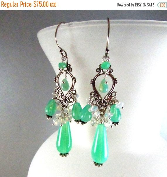 Vintage glass green opalite drops have been paired up with smooth white opaline rondelles. All components are sterling silver.  The earrings measure 2 5/8 (7cm.) from the top of the ear wires.