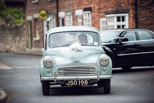 Pale blue vintage wedding car // photography www.andyhook.com/