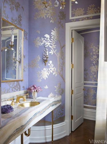 A lavender Gracie silk wallcovering brings romance to this powder room.
