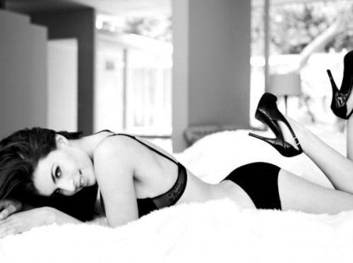Heels in bed, always sexy....yet classy.