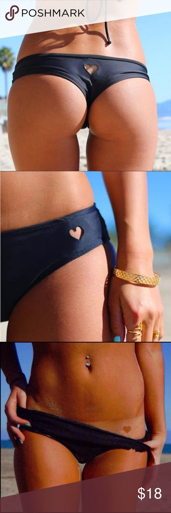 "Cheeky Brazilian Heart Bikini Bottoms Sexy & cute Brazilian cheeky bikini bottoms in black. Features one cut-out heart pattern on the front side, & one cut-out heart pattern on the back in the middle. Protective pantyliner intact. **These run very small!! I definitely recommend sizing up!!** Hips: S- 24""-28"" M- 25""-29"" L- 27""-31"" XL- 28""-33"" Don't see your size or favorite color but still want one?! Let me know!! Swim Bikinis"