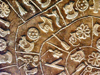 The inscription was apparently made by pressing pre-formed hieroglyphic seals into the soft clay, in a clockwise sequence spiraling toward the center of the disk. Photo Credit