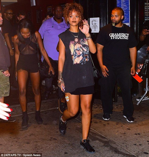 Casual cool: Rihanna dressed down while showing off her legs to attend a Travis Scott conc...