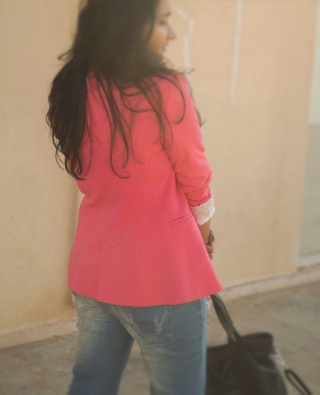 pink jacket with blue denims
