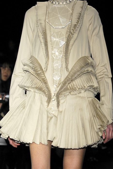 Givenchy F/W 2008 - inspired by skirts widen at the top, bodices elongate into a v-shape and ruffs grow exceptionally wide or high, during the Northern Renaissance period.