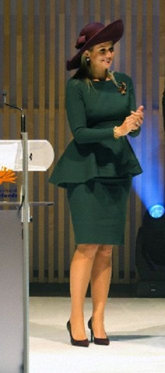 Dutch Queen Maxima's in winter green dress and she teamed her outfit with plum stiletto pumps as she presents the Prins Bernhard cultuurfonds Price 2013
