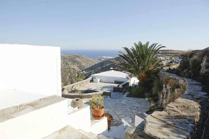 """The villa at the """"Vrissi"""" site in Sifnos is a point of reference of the Cycladic architectural tradition and without any doubt of natural beauty. Its spaces embrace you and fill you with respect for the Cycladic sensitivity and civilization.It is a house that gives the impression that it is curved in the rock like a proud eagle's nest. A horizon full of nature, the sea all around, with the wonderful view at the Kastro of Sifnos that can enchant you. #Sifnos #Greece #Cyclades #VillaVrissi"""