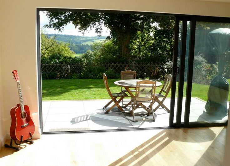 Triple sliding doors - all the views - none of the frame issues with bi-folding doors