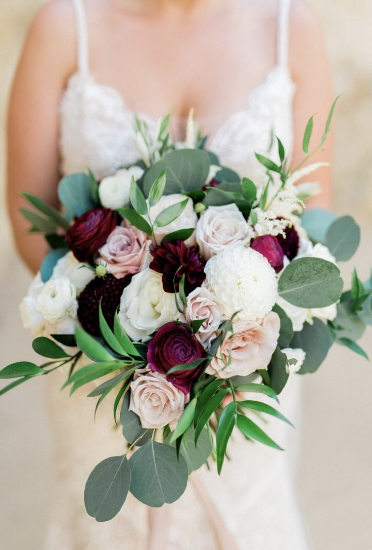 Blush and burgundy bridal bouquet with dahlias, ranunculus, garden roses, eucaly…