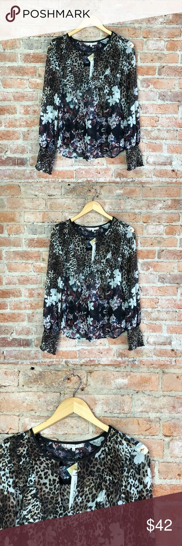Willow & Clay Leopard and Floral Print Blouse So gorgeous in person. If you're a gal that can get away with a little animal print, this top is for you!  Semi-sheer, so a cami would be required.  Beautiful with black jeans and heels. Willow & Clay Tops Blouses