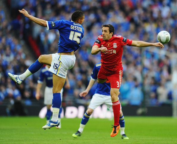Jose Enrique of Liverpool jumps with Rudy Gestede of Cardiff City during the Carling Cup Final match between Liverpool and Cardiff City at Wembley Stadium on February 26, 2012 in London, England.