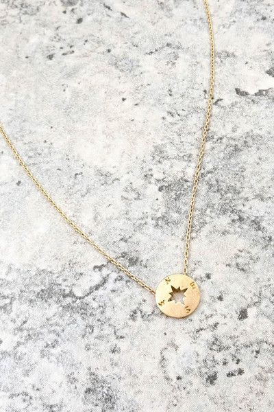 - Are you more of an understated gal? Our Westlyn Charm Necklace is the perfect accent for every day wear. A high quality metal compass charm sits delicately on a dainty durable chain. The smooth brus