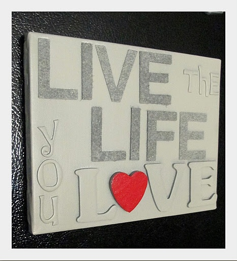 Canvas made from spray painting sticker letters and painting the heart.  Canvas has magnets on the back for fridge.  {Tutorial}