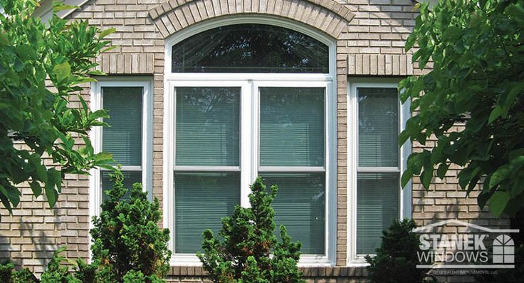 White double-hung windows with single prairie shadow V-groove and a custom-shaped window above. Learn more.