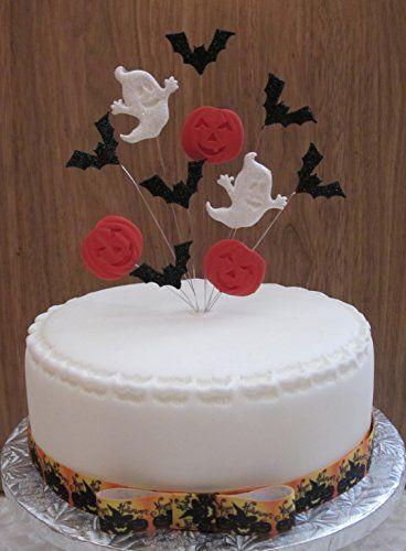 halloween cake topper with glittered moon bats and pumpk https